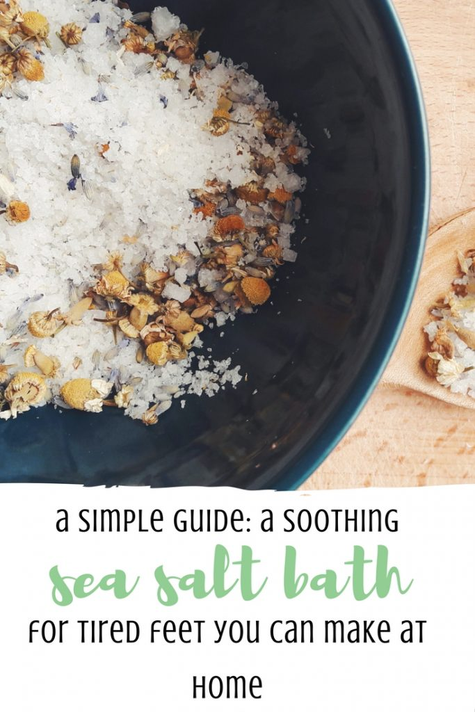 Soothing homemade sea salt bath for tired feet with dried flowers and essential oils